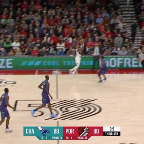 launches from deep to beat the buzzer!...