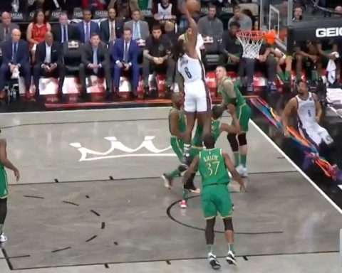 reaches UP for the alley-oop in Brooklyn!...