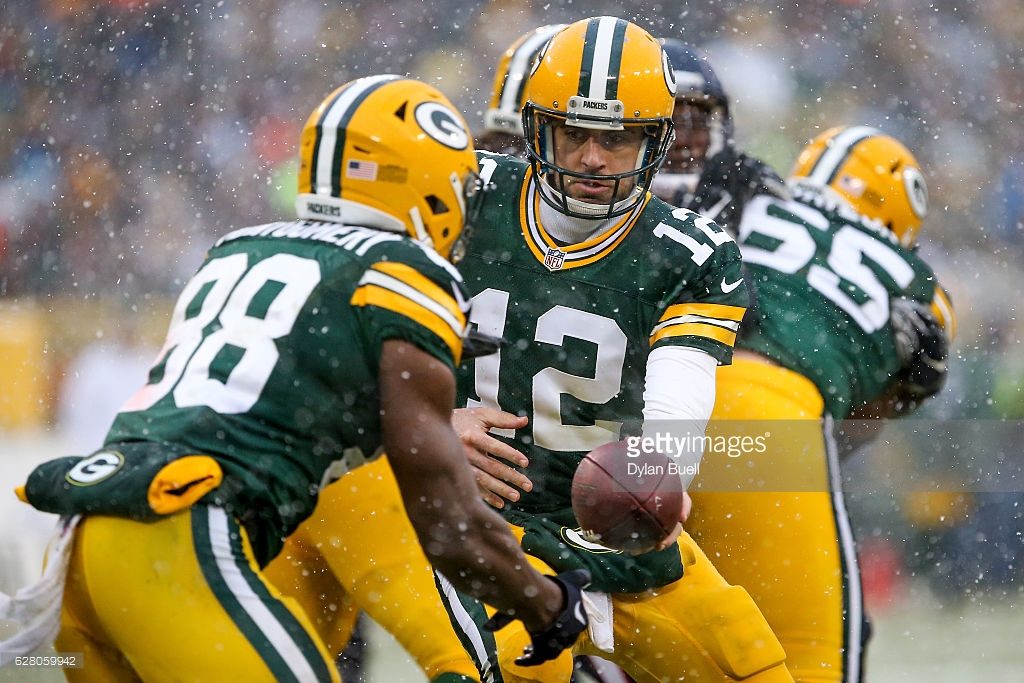 Aaron Rodgers #12 of the Green Bay Packers hands the ball off to Ty Montgomery #88 in the fourth quarter against the Houston Texans at Lambeau Field on December 4, 2016 in Green Bay, Wisconsin. (Photo by Dylan Buell/Getty Images) *** Local Caption *** Aaron Rodgers;Ty Montgomery